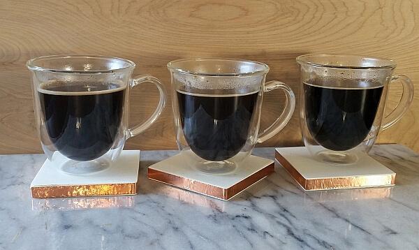 Three Glorybrew coffees in mugs.